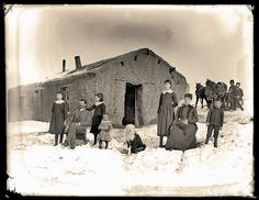 The Butcher family arrived in Nebraska in time to experience the hard winter of 1880 to 1881. Blizzards often struck without warning, catching people out on the prairie. Those lucky enough to be home, like this family shown here in Cherry County, often brought their horses or cows into their sod homes so the animals would not freeze.– Courtesy Nebraska State Historical Society ID. 11234 –