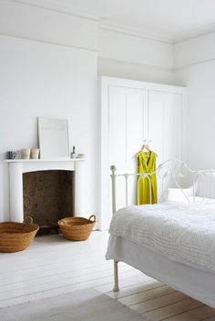 white bedrooms and wicker storage baskets
