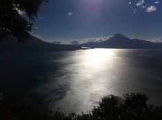 Sun shining in the afternoon over Lake Atitlán in Guatemala.