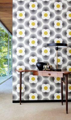Retro stylised flower heads in a 70s feel geometric wallpaper design by Orla Kiely.
