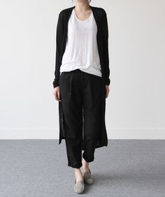 Black and white: long black cardigan. Via Death by Elocution