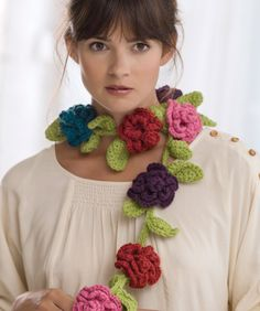 Belle Fleur Scarf free pattern. I don't think I'd wear this, but looks like it would make a beautiful bunting or garland--how about white and red Christmas roses on a dark green vine wrapped around the staircase railing or along the mantle?