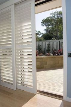 Plantation shutter sliders to cover sliding glass door.