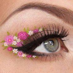 How gorgeous is this eyeshadow art?! Springtime flower eyes!