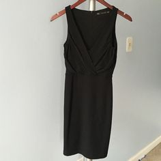 NWT Zara black dress, size S Sexy black dress from Zara's Trafaluc collection. Deep V-neck with draping details. Form fitting, sleeveless and hidden back zipper. Size small. Length is 34 inches. Brand new, never been worn with tags still on. Perfect for a date night or a girls' night out! Zara Dresses Midi