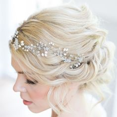 The beautiful handmade Fern bridal hair vine is an exquisite statement piece made with Swarovski crystal and the finest freshwater pearls, entwined and suspended amongst Gold or Silver plated wire. Bohemian inspired wedding headpiece designed & handmade in the UK by British bridal designer Rachel Chaprunne It is flexible and can be worn asymmetrically along loose curls, positioned along the curve of a romantic upstyle or woven into braided hair
