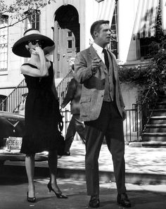 "Audrey Hepburn and George Peppard in ""Breakfast At Tiffany's"" (1961): Holly whistles down a NYC cab."