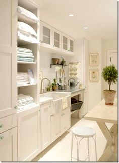 The other side of the laundry above shows its large sink, a must in my opinion.  A big farm sink would be great for washing pets if you have them.    The table is for folding clothes and towels.