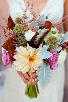 Autumn Wedding Bouquet Which Includes: Champagne Dahlias, White Ranunculus, Dusty Pink Roses, Pink Astilbe, Scabiosa Pods, Fall Foliage + Dusty Miller