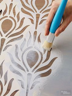 Give an old table a stylish new face with this simple stain-and-stencil furniture makeover.                                                                                                                                                      More