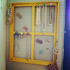 Old wooden window turned jewelry holder!