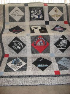 tshirt quilt square in square with sashing and cornerstones.  The consistent grey shirts make a great symmetry in this quilt top.