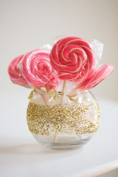 Flowers not in season or in budget? Opt for bright lollipops instead and treat guests to a centerpiece AND a party favor.