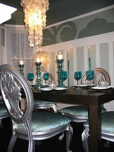 Gorgeous aqua and silver dining room with Capiz shell chandelier. Designer David Bromstad of Color Splash