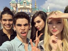 "The cast of Disney's Descendants took this awesome squad pic in front of the Disneyland castle.  Cameron Boyce posted it on his Instagram with the caption ""When the sun is burning your retinas but you're so excited for your sequel you're willing to endure the pain for that good light #Descendants2""  We're so excited for Descendants 2, too! We love seeing the cast together! Twitter: @TheCameronBoyce  Instagram: @xmob_bboytruth  Photo: Cameron Boyce/Instagram"