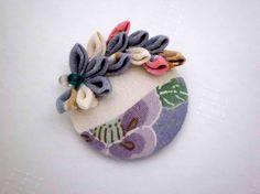 Hey, I found this really awesome Etsy listing at https://www.etsy.com/listing/203717565/vintage-kimono-covered-button-hair-clip