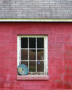Photo of a cinder block farm shed with a nine-pane window. A circular saw leans against the window sill, a blue water sprayer and rake lean against the window inside.This print is now available in my Etsy shop at www.etsy.com/shop/AnneFreemanImages  I ship worldwide.  Click on the link for print details and to order.   ~ Anne Freeman Images ~ Prints to Make you Smile ~ Barn Window Photo  Circular Saw Blade Photo  by AnneFreemanImages