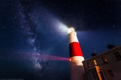 Portland Bill Lighthouse at night with the Milky Way, Portland.