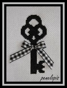 Cute key cross stitch pattern; I just finished making this for a friend. The proportion looks a little weird without the ribbon. If I made it again, I'd make the shaft of the key a bit longer. But it is cute!