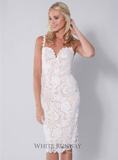 Blushing Belle Dress. Stunning lace dress by Australian designer Love Honor. A flattering midi dress with a sweetheart neckline and corset bodice. Available in Black, White, Black/Nude, Peach & White/Nude.