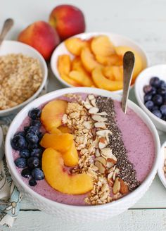 Start your day with a Peach Blueberry Smoothie Bowl or add it in to your afternoon as a nice pick-me-up. This smoothie bowl combines milk, Greek yogurt, peaches, blueberries, honey and chia seeds and topped with your favorite toppings to create a sweet, healthy smoothie bowl you will love. // A Cedar Spoon