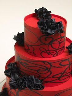 Black and red wedding cake with swirls.
