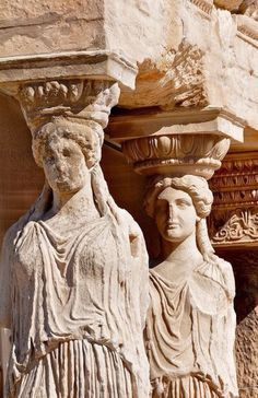"""The Caryatids of the Erechtheion on the Acropolis of Athens. The Greek term karyatides literally means """"maidens of Karyai"""", an ancient town of Peloponnese. Karyai had a famous temple dedicated to the goddess Artemis in her aspect of Artemis Karyatis: """"As Karyatis she rejoiced in the dances of the nut-tree village of Karyai, those Karyatides, who in their ecstatic round-dance carried on their heads baskets of live reeds, as if they were dancing plants""""  (Kerenyi 1980 p 149),"""