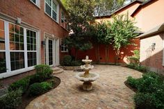 10807 Brenner Creek Ct . Stunning courtyard with flowering trees. Perfect for enjoying the outdoors; serene, stunning and private.  Plenty of room for dining and entertaining. Bernstein Realty, Houston Real Estate