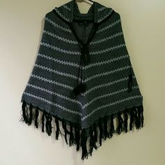 BCBG PONCHOS. new never worn. Beautiful ponchos.  Color.Black,grey,gold. BCBGMaxAzria Sweaters Shrugs & Ponchos