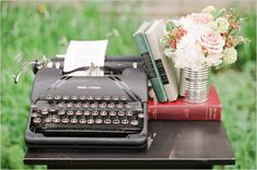 Vintage typewriter centerpiece. Add a sheet with special song lyrics or poem. Use books as shown here, but use a mason jar for flowers and burlap runner underneath.