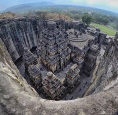 The Kailasa temple was carved out of one single rock. Also known as 'Cave of the Ellora Caves, it is notable for being the largest monolithic structure in the world carved out of a single piece of rock. The Kailasa temple was carved out of one s Indian Temple Architecture, Architecture Antique, India Architecture, Places To Travel, Places To Visit, Tourist Places, Temple India, Hindu Temple, India Travel Guide
