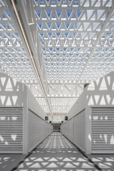 Perforated canopy shelters stalls at modernised Portuguese marketplace Arch Light, Canopy Shelter, Market Stands, Triangular Pattern, Traditional Market, Geometric Tiles, Metal Canopy, Ground Floor Plan, Garden Features