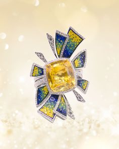 Discover the Joyful ring from our new collection Tesserae: an intense yellow radiates from the central sapphire of 11,70ct. surrounded by rays decorated in diamonds and micromosaic tesserae from yellow to blue. Joyful, Yellow, Blue, Jewelry Box, Sapphire, Diamonds, Jewels, Rings, Accessories