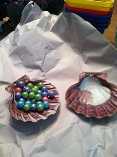 For  a Little Mermaid party Clam shells filled with pearl gum balls