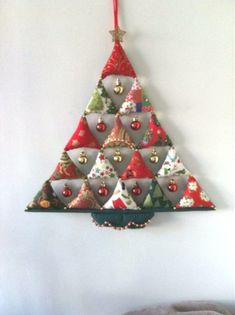Very simple, 15 stuffed triangles with small baubles… Christmas tree decoration. Very simple, 15 stuffed triangles with small baubles hanging between. Fabric Christmas Trees, Hanging Christmas Tree, Small Christmas Trees, Felt Christmas, Simple Christmas, Handmade Christmas, Christmas Tree Decorations, Christmas Wreaths, Christmas Ornaments