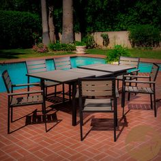 @Overstock - Ideal for relaxing poolside or on the patio, this Laguna outdoor dining set is constructed of strong yet lightweight aluminum and poly wood. This outdoor entertaining set includes an expandable rectangular table and a set of six chairs.http://www.overstock.com/Home-Garden/Christopher-Knight-Home-Laguna-Black-Frame-Outdoor-7-piece-Dining-Set/6765073/product.html?CID=214117 $1,099.99