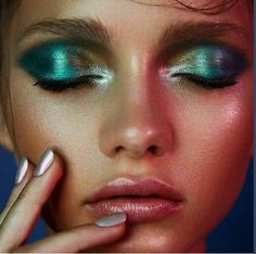 Mermaid eyes - yellow/blue/green/purple metallic eyeshadow look with pink lips.