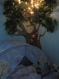 3D tree wall mural. I just like the lights part