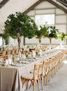 While you might think that branches are more of a winter wedding statement, you can totally make it work for your summer wedding centerpieces, too. Try a taller branch that has a few blooms or more greenery for the perfect compromise.
