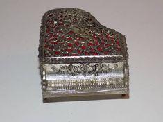 Check out this item in my Etsy shop https://www.etsy.com/listing/533521330/vintage-sankyo-filigree-cherub-jewelry