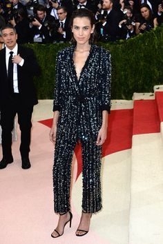 Alexa Chung #MetGala2016 Trust Chung to turn the tables on the cut-out/metallic/techno crew in a David-Bowie-inspired Thakoon sequinned pyjama suit.