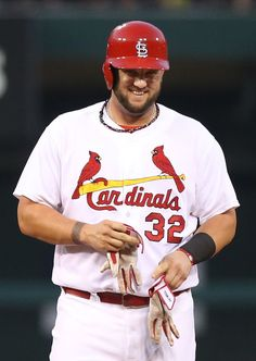 St. Louis Cardinals' Matt Adams smiles towards the dugout after driving in a run with a double in first inning action during a game between ...