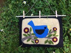 Folk Art Penny Rug Wall Hanging Blue Bird on a Branch wall