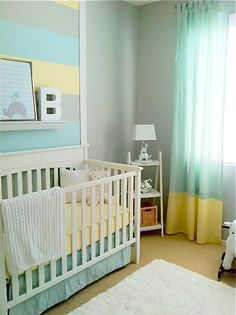 trim wall same width as crib, thick painted stripes within - match West Elm multi striped rug!