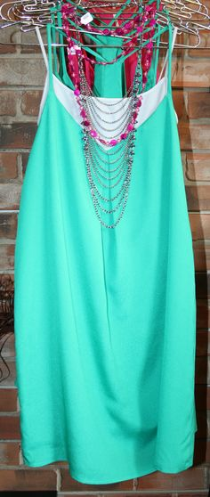 Teal tunic to pair with bright jewelry.