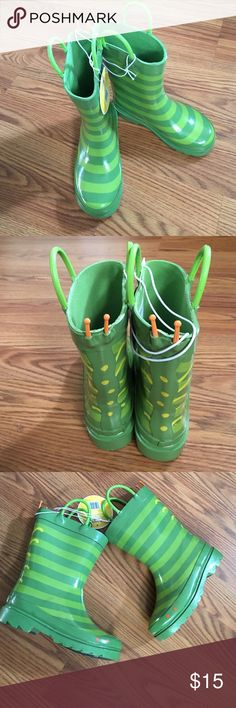 """2 X Host Pick  Kids Caterpillar Rain Boots • Rubber upper construction repels water • Leather and rubber non-marking outsole won't leave marks • No heel • Pull-on straps  • Striped pattern • 7"""" shaft height hits mid-calf • 7"""" shaft circumference • Water-resistant  Your little gardener will love splashing around in these Kids' Gardening Boots with Caterpillar Stripes. Durable and water-resistant, these adorable boots take on the characteristics of a caterpillar to make wet days more fun. Two…"""