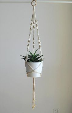 Weddbook is a content discovery engine mostly specialized on wedding concept. You can collect images, videos or articles you discovered  organize them, add your own ideas to your collections and share with other people - Decorative macrame plant hanger with golden drops at the end. Perfect addition to boho wedding or home indoor garden.   READY TO SHIP  >> color:  natural cotton/ecru/beige/linen  >> measurements: (this listing is for the macrame plant hanger only, does not include plant or…