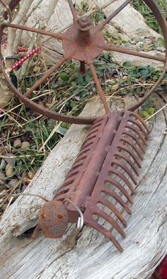 Cute! ...LOOKS LIKE 2 GARDEN RAKES AND A RR SPIKE...