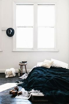 that blanket makes me happy. also the floors and openness of the room are dreamy