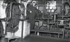 A rare photograph taken inside the Maori's boiler room, probably her forward stokehold, after her conversion to oil burning in 1923. The engineer is standing beside one of two Worthington oil pressure pumps; part of the pump's steam engine is at right. Behind the pump and its gauge board, the curvature of the Maori's hull plates can be seen (Alexander Turnbull Library, National Library of New Zealand. Negatives of the Evening Post newspaper, Ref: 1/4-009813-G)